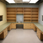 Exam room with counters and shelving