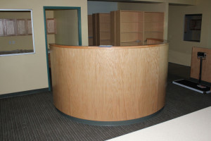 Reception desk with curved wood front