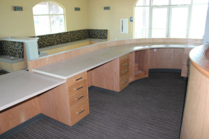 Reception area with curved wood partition